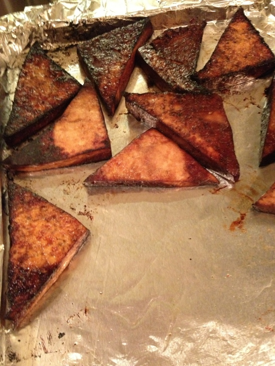 Tofu triangles marinated in soy sauce & balsamic vinegar, roasted in the oven for 10 min.